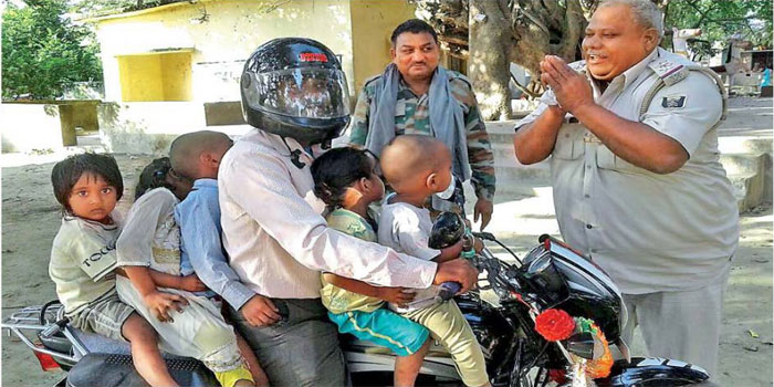 traffic police fold hand seeing this biker